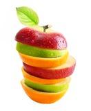 Äpfel und orange Frucht Lizenzfreie Stockbilder