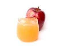 Äppelmust och äpplen Arkivfoto