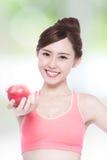 Äpple för leendekvinnahåll Royaltyfri Bild