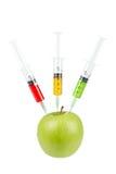 äpple - green satte in injektionssprutor tre Arkivbilder