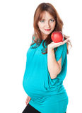 äpple som rymmer den gravida le kvinnan arkivbild