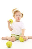 äpplen behandla som ett barn flickagreen Arkivbilder
