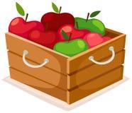 äpplen box trä Arkivfoto