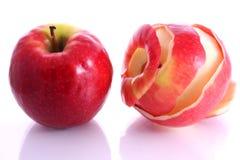 äpplen ett skalade två royaltyfria foton
