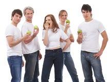äpplen fem gröna folk Fotografering för Bildbyråer