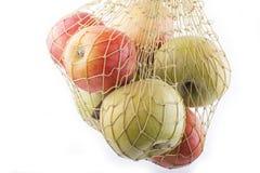 Äpplen i netto Arkivfoto