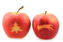 Äpplen med julsymboler Arkivfoto