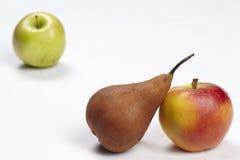 Äpplen och ett päron Royaltyfri Foto