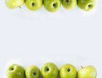 Äpplen på gränsen av bilden med kopieringsutrymme för text Royaltyfri Fotografi