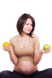 äppleorangegravid kvinna Arkivfoto
