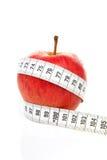 äpplet bantar måttbandet Arkivfoto