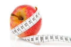 äpplet bantar måttbandet Fotografering för Bildbyråer