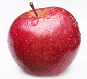 äpplet gjorde ren rött vatten för droppe Arkivfoton