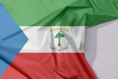 Äquatorialguineagewebeflaggenkrepp und -falte mit Leerraum stockfotografie