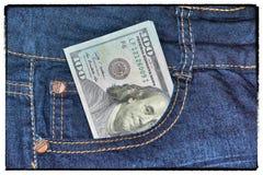 Är amerikanska pengar för tappningusd i facket av jeans Royaltyfri Foto