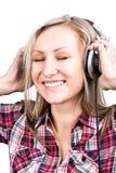 Är den blonda flickan för härlig vuxen sensuality lyssnar t arkivfoton