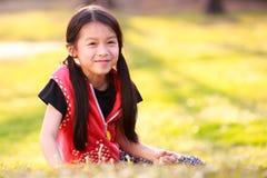 Är den unga asiatiska flickan för closeupen lycklig Arkivbilder