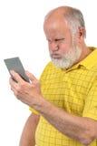 Är fräck mot den skalliga mannen för pensionären med pustt upp Fotografering för Bildbyråer