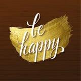 Är glänsande kalligrafi för metallisk folie den lyckliga affischen För tryckmålarfärg för vektor guld- design för fläck på Wood b Royaltyfria Bilder