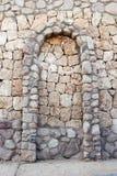 ärke- bjälkhuvudstenvägg Royaltyfri Bild