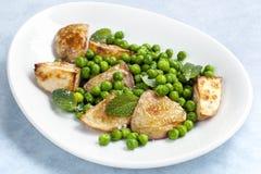 Ärtor och potatisar med mintkaramellen Royaltyfri Bild