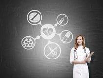 Ärztin und medizinische Ikonen Stockbild