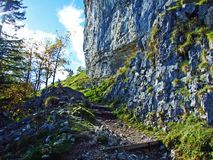 "Ã""scher cliff or Ã""scher-Felsen Aescher-Felsen or Ascher-Felsen in the Alpstein mountain range and in the Appenzellerland region. Canton of Appenzell royalty free stock image"