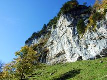 "Ã""scher cliff or Ã""scher-Felsen Aescher-Felsen or Ascher-Felsen in the Alpstein mountain range and in the Appenzellerland region. Canton of Appenzell royalty free stock photography"