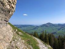 "Ã""scher cliff or Ã""scher-Felsen Aescher-Felsen or Ascher-Felsen in the Alpstein mountain range and in the Appenzellerland region. Canton of Appenzell royalty free stock photo"