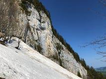 "Ã""scher cliff or Ã""scher-Felsen Aescher-Felsen or Ascher-Felsen in the Alpstein mountain range and in the Appenzellerland region. Canton of Appenzell stock photos"