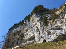 "Ã""scher cliff or Ã""scher-Felsen Aescher-Felsen or Ascher-Felsen in the Alpstein mountain range and in the Appenzellerland region. Canton of Appenzell stock photo"