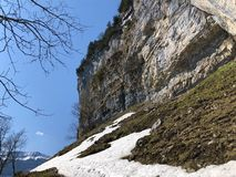 "Ã""scher cliff or Ã""scher-Felsen Aescher-Felsen or Ascher-Felsen in the Alpstein mountain range and in the Appenzellerland region. Canton of Appenzell stock image"