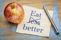 Äta bättre, inte mindre - servettbegreppet Royaltyfria Foton
