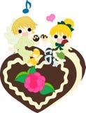 Äta choklader med en ängel Royaltyfria Foton