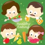 äta den sunda familjen Royaltyfri Bild