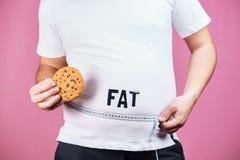 Äta för mycket frossare, sockerböjelse, skräpmat arkivfoto