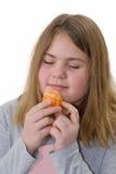 äta flickaorangen Fotografering för Bildbyråer