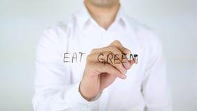 Äta gräsplan, manhandstil på exponeringsglas Royaltyfri Fotografi