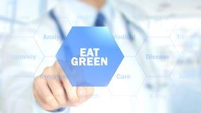 Äta grönt, manipulera arbete på den holographic manöverenheten, rörelsediagram Arkivfoton