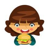 äta hamburgarekvinnabarn Royaltyfria Bilder