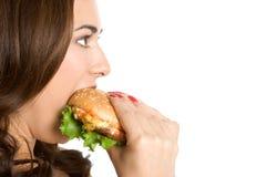 äta kvinnan royaltyfri fotografi