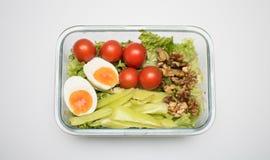 Äta lunch för att ta på ditt arbete som isoleras på vit bakgrund arkivfoto