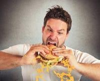 Äta med våldsam häftighet Arkivbilder