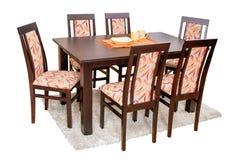 Äta middag tabellen och stolar som isoleras på vit med den snabba banan Royaltyfri Fotografi
