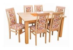 Äta middag tabellen och stolar som isoleras på vit med den snabba banan Arkivbild