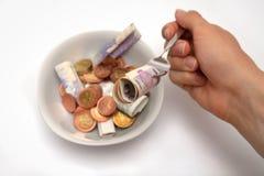 äta pengar Arkivbild