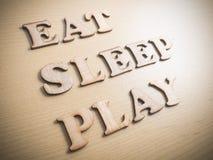 Äta sömnlek, Motivational ordcitationsteckenbegrepp royaltyfria bilder