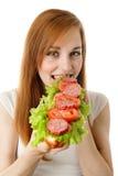 äta snabbmatkvinnabarn Royaltyfria Foton