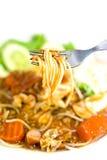 Äta spagetti arkivbild