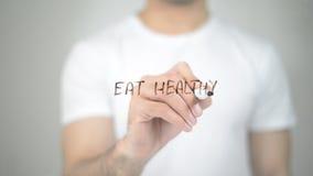 Äta sunt, manhandstil på den genomskinliga skärmen Arkivfoto